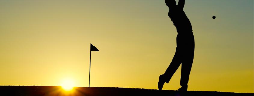 golfeur soleil couchant